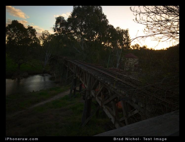 High contrast iPhone 8Plus DNG torture test. Dark bridge taken agains light from setting sun, very dark exposure.