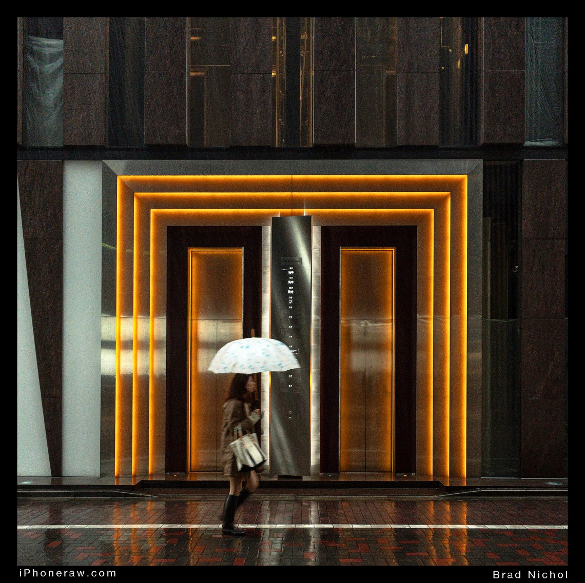 lady in rain in Ginza lane in drenching rain, running, neon door surrounds in background.