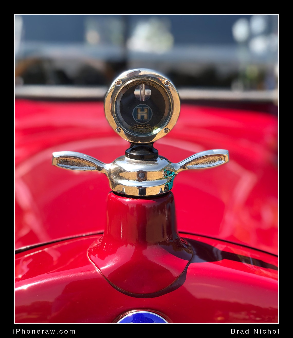 Radiator gauge on antique vehicle, red, iphone X portrait mode, good result, nice background blur, hupmobile.