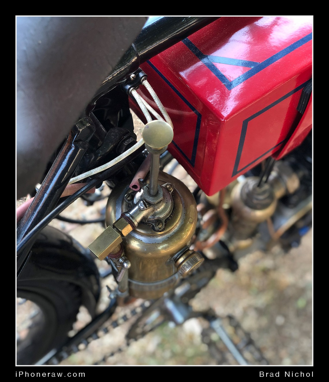 Antique motorcycle hand oil pump, iPhone X, portrait mode.