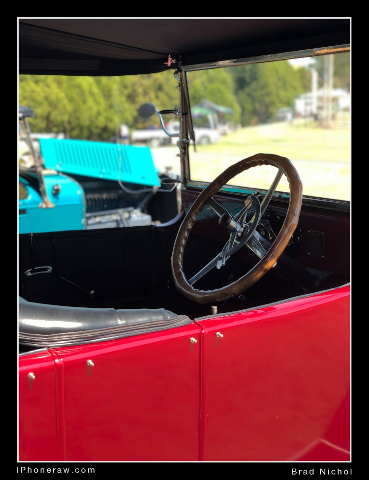 Vintage vehicle interior against bight background, iPhone X portrait mode, bright colours, some background clipping, good shallow depth effects.