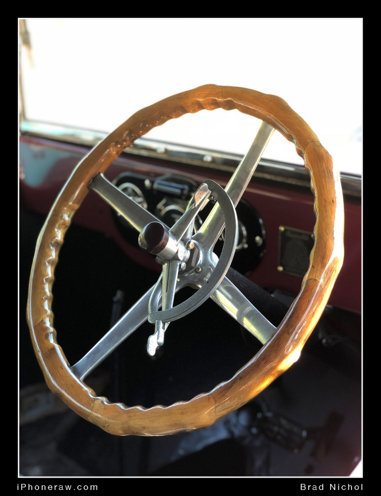Photo of wooden steering wheel on vintage car taken with iPhone X portrait mode.